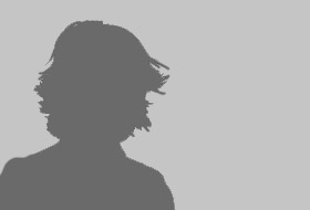 A silhouette of a young adult woman isolated on a white background.